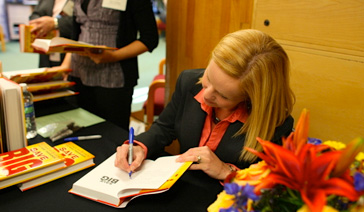 Author-Elisabeth Leamy-signs Save BIG for fans at the New Jersey Financial Literacy Summit