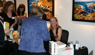 Author-Elisabeth Leamy-Signs her The Savvy Consumer at Consumer Credit Counseling Service Event