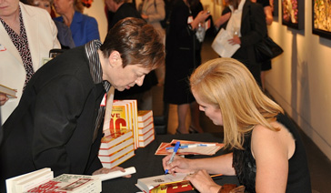 Author-Elisabeth Leamy-Signs Save BIG for a fan at CCCS of Dallas Event