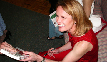 Author-Elisabeth Leamy-Hands a fan her book-The Savvy Consumer