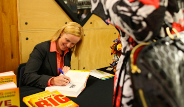 Author-Elisabeth Leamy-Signs Save BIG at New Jersey Financial Literacy Summit