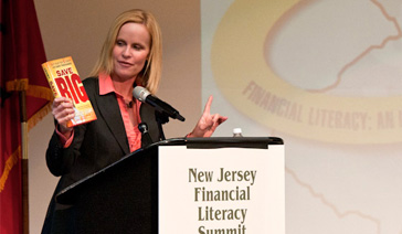 Keynoter-Elisabeth Leamy-Asks What is Financial Literacy-In Motivational Speech